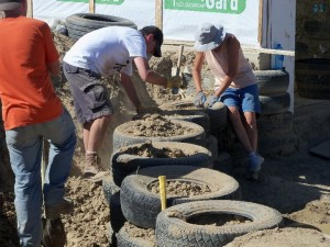I and sister Teri pack dirt into old tires for Earth Ship