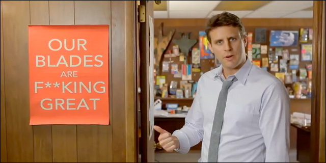 "Still from video introducing Dollar Shave Club, with founder Michael Dubin pointing to sign that says ""Our Blades are F**CKING great"